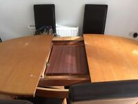Wooden extendable dining table seat 6 but extends to seat 8
