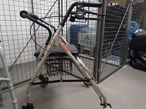 Walker URGENT  MOVING SALE  with basket and seat