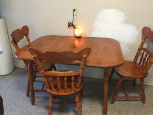 Dining table with 4 chairs. Asking 20.00 obo