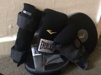 Boxing gloves and pads and knee support