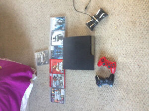 PS3 with 2 wireless remotes and 7 games