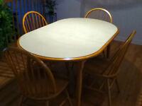 Solid wood table with leaf and four chairs
