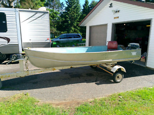 Mid 1980s 12 foot thorns boat motor and trailer