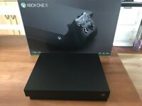 Xbox one X 1tb with GTA 5 and 7 months warranty remaining
