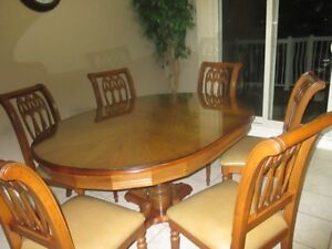 On sale a beautiful kitchen table Oval solid oak wood Covered wi