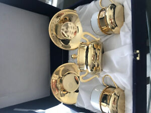 Gold plated made in German , 8 piece tea cups sauser set