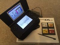 Nintendo DS lite with 4 games , charger and case