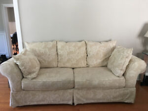 Plush, well-maintained, off-white fabric, 98' couch.