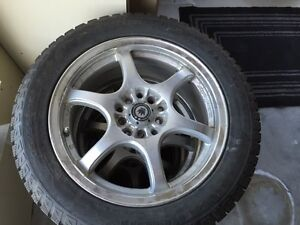 Konig Monza Japan 6 spoke rims w/studded 205/55 R16 winter tires