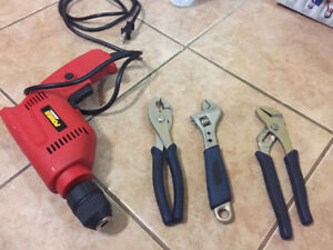 Drill, hand saw, and tools