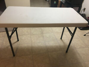 Rectangular white table with black metal base