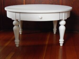 "35 1/2"" Round White coffee table with drawer"