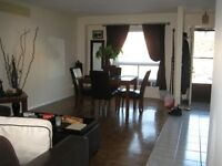 Bright Spacious End Unit Close to all amenities!