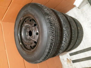 4 Firestone all season tires on steel rims