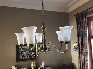 Brass Chandeliers with 5 lights.