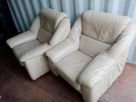 2 cram leather arm chairs