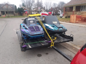 2 snowmobiles and tilt double wide trailer