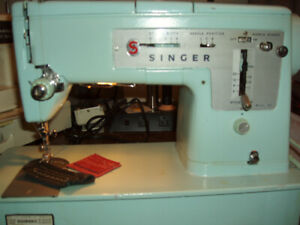 2  sewing machines for sale.