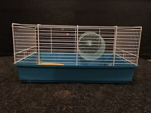 Hamster cage with wheel and dish