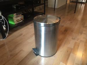 Bin with foot activated lid