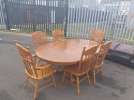 41. Tiger oak table and 6 chairs with 2 carvers