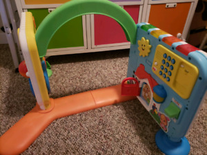 Crawl n play baby book and a tub toy