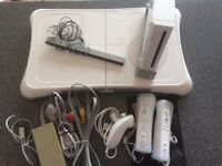 wii console, wii fit board. nunchuck, 2 contols and 6 games.