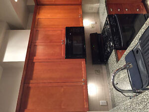 Kitchen cabinets and stove with microwave North Shore Greater Vancouver Area image 4