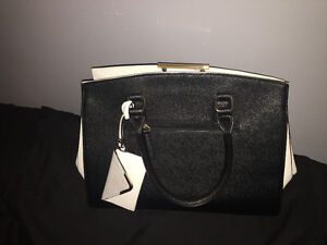 Handbag with synthetic leather protector