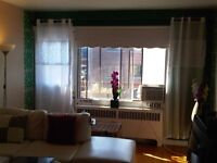Bright room for rent in a beautiful apartment in Pointe Claire