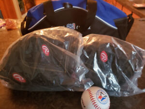 2 Rawlings mitts, bag, and baseball