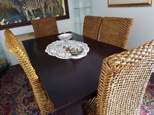 Beautiful dinning table with 6 rattan chairs