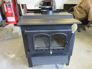 medium size wood stove 6yrs old never been installed like new
