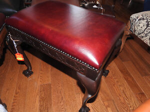 antique bench seat, new leather, ball and claw feet