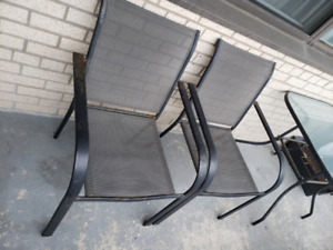Patio set, 2 chairs and a glass table