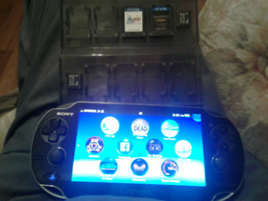 PS Vita emaculate condition games and charger