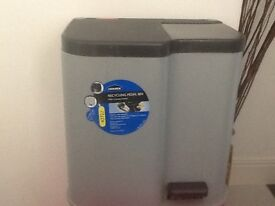Recycling bin with two compartments