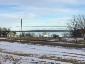 LARGE, LEVEL BUILDING LOT WITH WATER VIEW AND DEEDED WATERFRONT