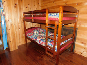 For Sale twin on twin bunk bed solid wood with mattresses.
