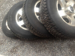 4/ KIA WINTER TIRES & 4/TOYOTA TERCEL TIRES  ON RIMS