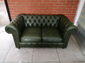 A Dark Green Leather Chesterfield Two Seater Sofa