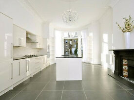 SUPERB 5 bedroom mezzanine apartment with private balcony in a period conversion in Belsize Park.