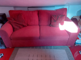 Red two seater sofa and matching chair