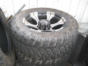 3 dc rims and 4 tires