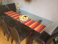 Beautiful glass top dining table and mahogany chairs