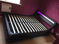 4 months old. Led king size ottoman bed. One broken slat. Only selling as I'm moving out