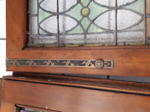 antique doors. stain glass. double doors with hinges