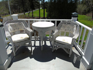 VINTAGE WICKER TABLE AND 2  VINTAGE WICKER CHAAIRS