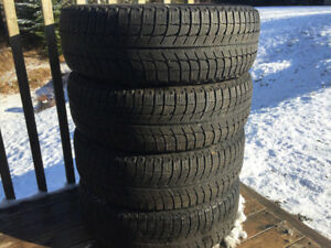 Four Michelin X-Ice 195/65R15 Winter Tires