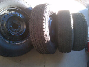 4- Winter tires & rims, 95% good, 215-75-15 of Geep Cherokee
